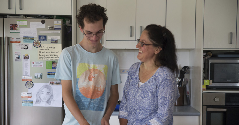 Raymond Clough cooking with his mother Stephanie