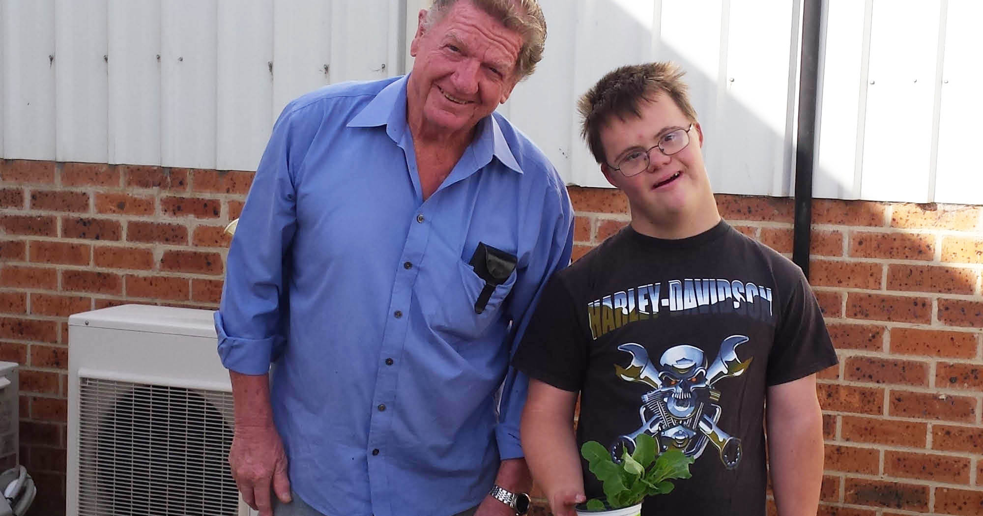 Denny and a Northcott customer smiling and working in the sensory garden