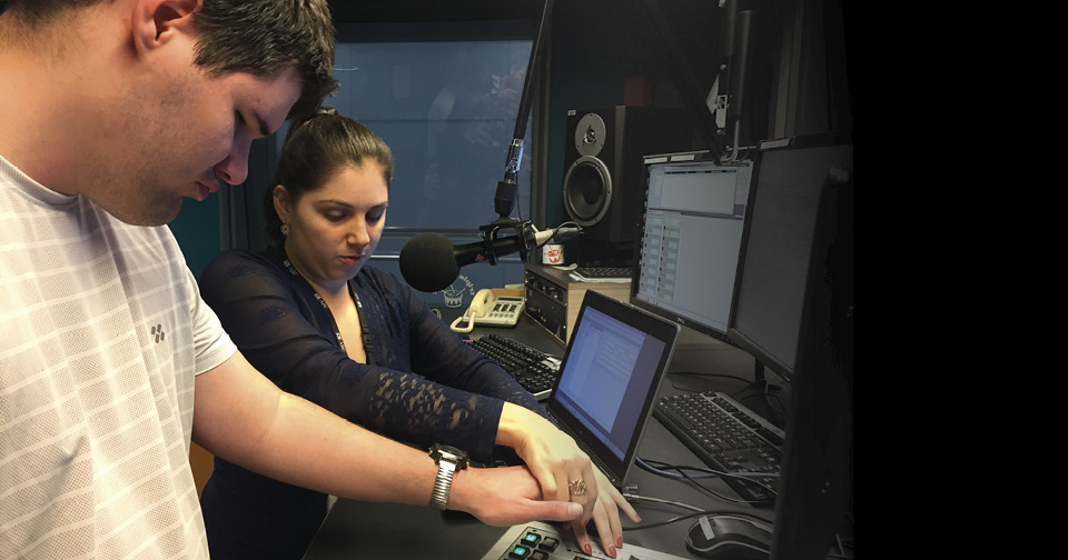 Aaron Newtown and Nas Campanella using equipment in the Triple J studio.