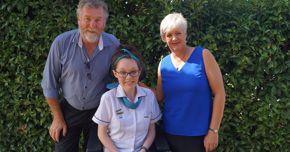 Wheelchair user Sarah Walsh with her parents
