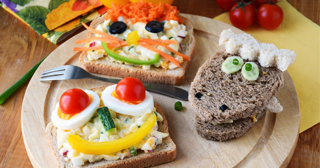 Funny sandwich with faces for kids. Colorful and healthy breakfast
