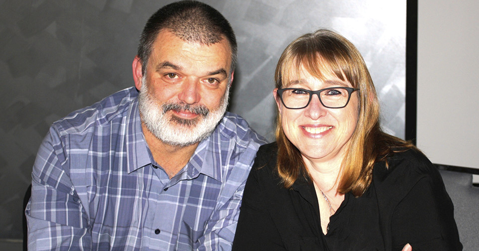 2 people have a blast at the Northcott Spina Bifida Awareness Week comedy night and dinner evening