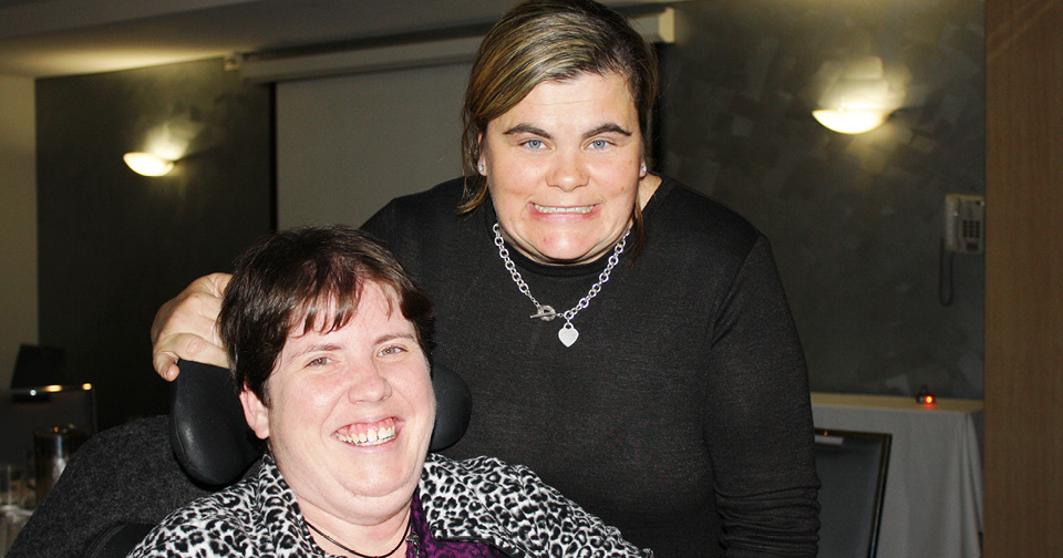 A Northcott staff member and customer have a great time together at the Spina Bifida Comedy Awareness Night